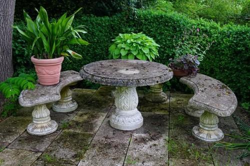 How to Decorate Your Garden With Stone Seats and Tables